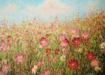 Campo de flores en primavera, con una mezcla exuberante de vegetación dando un colorido singular lleno de luz y con una gran diversidad de colores.