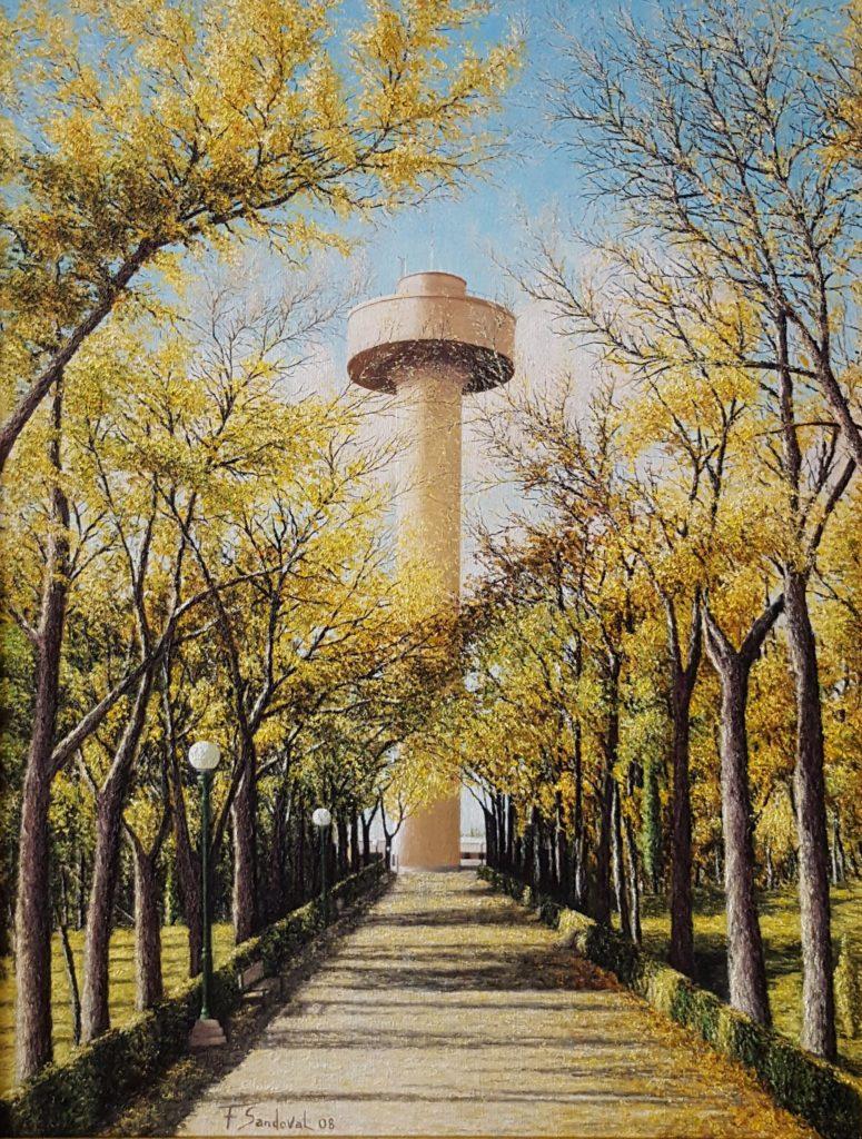 Depósito del agua de la Fiesta del Árbol con una altura de 67,3m, destacando los colores del otoño de los olmos del paseo.