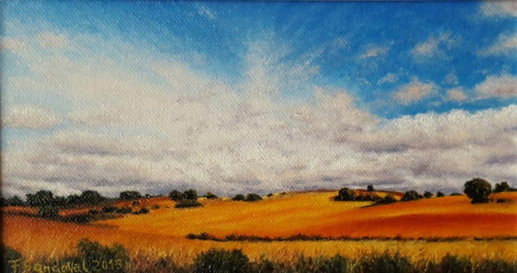 Campo manchego tan típico de las tierras manchegas, con esos colores anaranjados y rojizos, adornados en su paisaje con sus encinas centenarias.